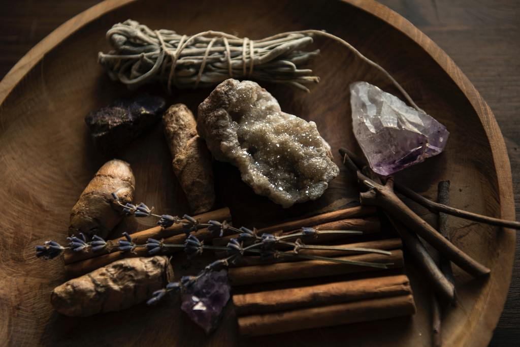 witch bowl full of crystals, sage, cinnamon, and lavender