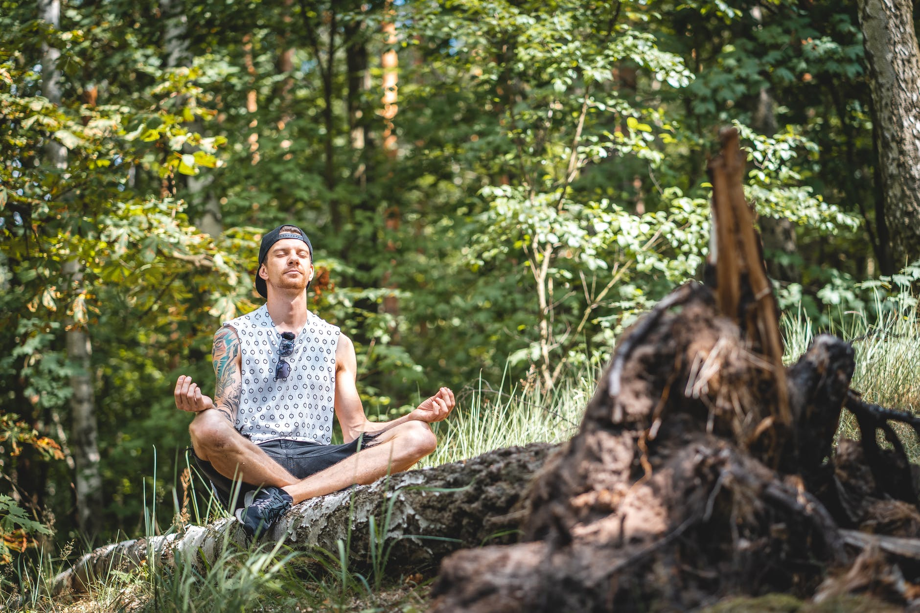man meditating in the woods